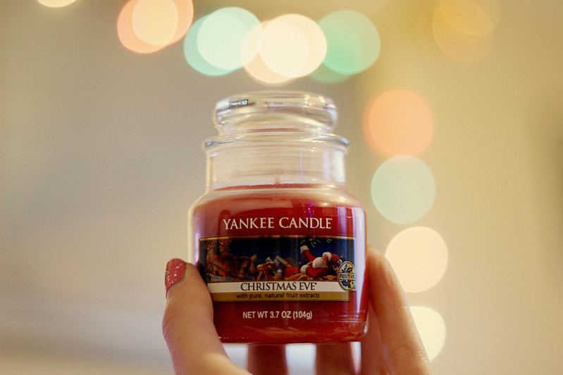 person holding the best yankee candle scents